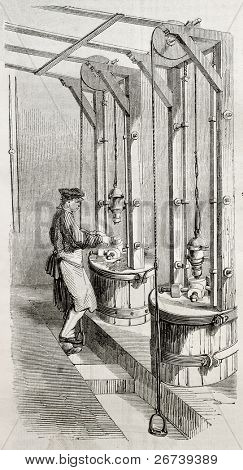 Old illustration of man working with punching machine in a needle factory. By unidentified author, published on Magasin Pittoresque, Paris, 1850