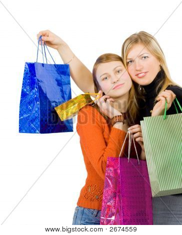 Two Girlfriends Hugging Having Made A Shopping Run