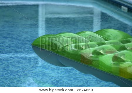 Inflatable Bed Floating On Private Swiming Pool