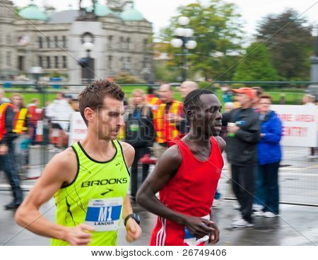 VICTORIA, BC, CANADA - OCTOBER 10: Runners James Lander (Esquimalt, BC) and Philip Samoei (Eldoret, RF) compete at the GoodLife Fitness Victoria Marathon October 10, 2010 in Victoria, BC, Canada.