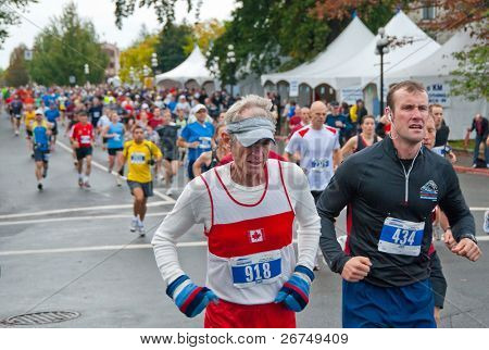 VICTORIA, BC, CANADA - OCTOBER 10: Runners Rob Grant (Victoria, BC) and Jeff Carlyon (Victoria, BC) compete at the GoodLife Fitness Victoria Marathon October 10, 2010 in Victoria, BC, Canada.