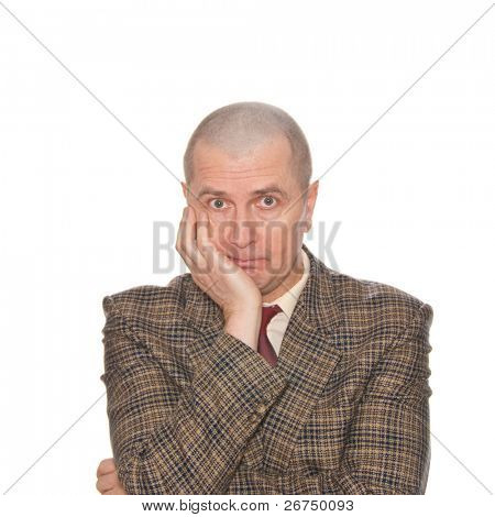 A businessman holding his head. Isolated on white. Body language. Boredom. Tedium.
