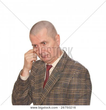A businessman touching his eye. Isolated on white. Body language. Manifest of telling untruth.