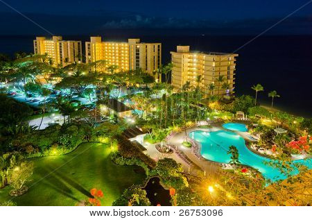 luxury resort with pool at night view