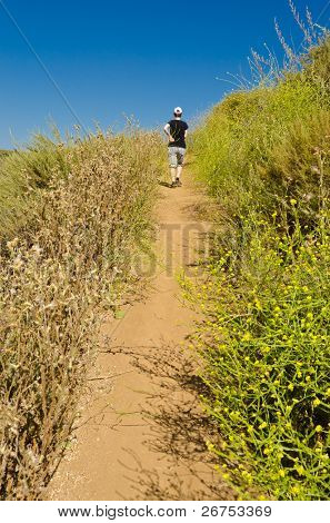 Woman walking (running) on the Long Canyon trail at Simi Valley, California, US