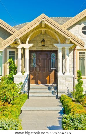 Entrance of a house with garage door and window over beautiful outdoor landscape