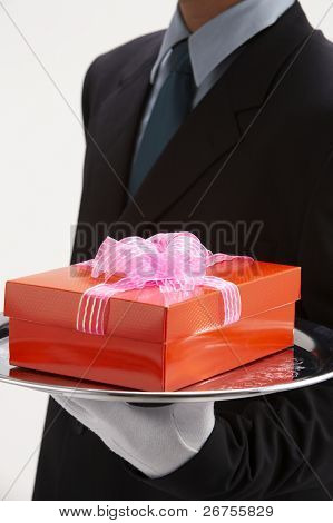 man holding exclusive presents to someone special