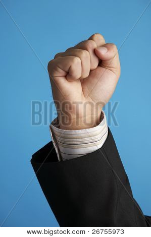 man raising the hand on the blue background