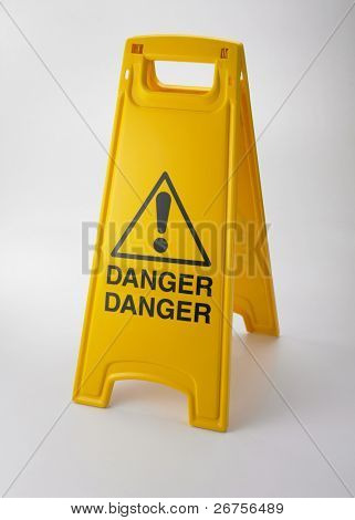 yellow color sign with text of danger on it