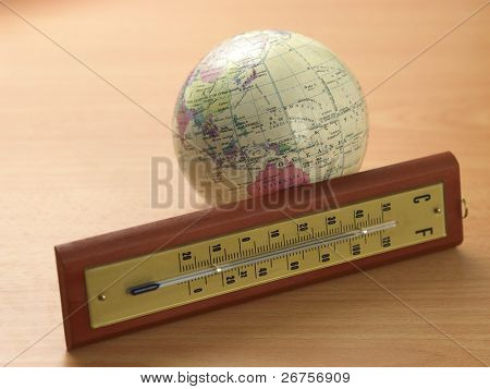 Thermometer in front of the desk globe
