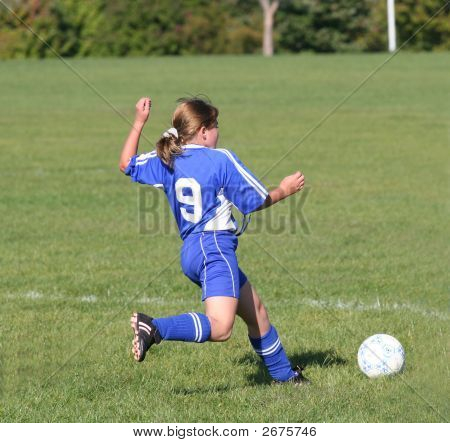 Teen Youth Soceer Player Kicking Ball