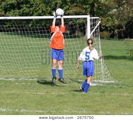 Teen Youth Goalie Stopping Ball