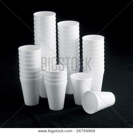 Styrofoam cups isolated on black background.