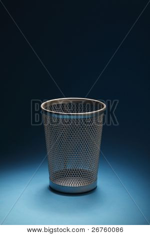 empty trash bin  on the blue background