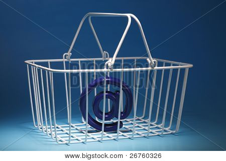 wire basket with at sign on the blue background