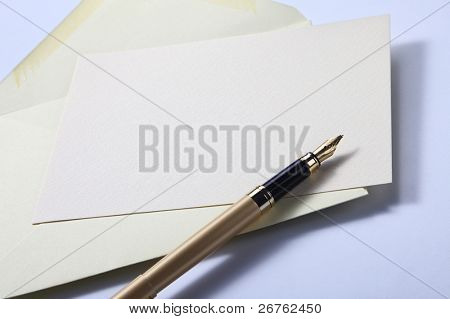 pastel yellow envelope letter and pen