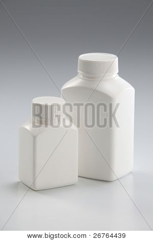 Two white medicine bottle closed on plain background