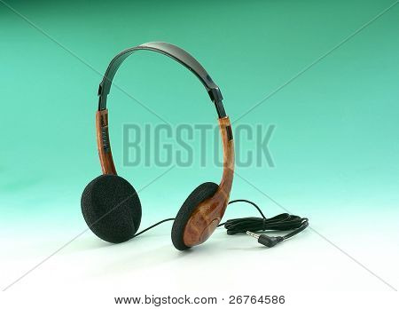 Ear-phone on a green background