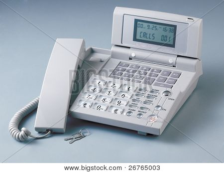 Modern Caller ID Phone With Receiver down on a plain background with clipping path.