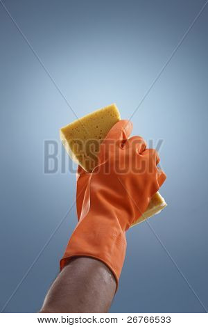Closeup of hand with cleaning sponge.