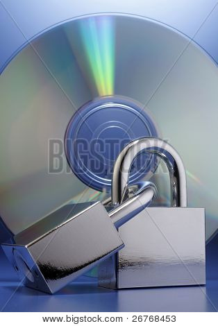 Padlocks in front of a compact disc.