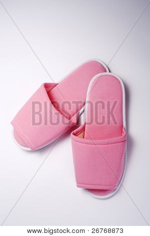 Pink slippers isolated on the white background.