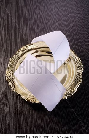 roll of paper on the golden plate