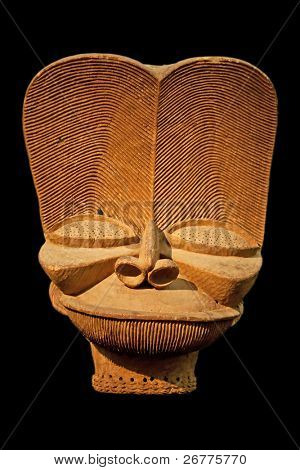 African wooden mask isolated on black