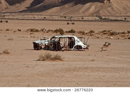 Abandoned car wreck in the desert
