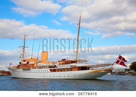 "COPENHAGEN - AUGUST 25: The Danish Queen's Naval Yacht ""Dannebrog"" expecting arrival of the Queen in Copenhagen harbor on August 25, 2010 in Copenhagen."