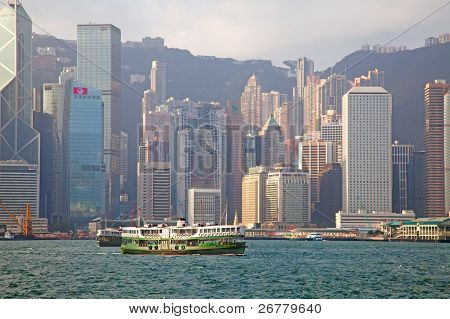 HONG KONG - DECEMBER 3: Ferry cruising Victoria harbor on December 3, 2010 in Hong Kong, China. Hong Kong ferry is in operation for over 120 years and it is one main tourist attractions of the city.