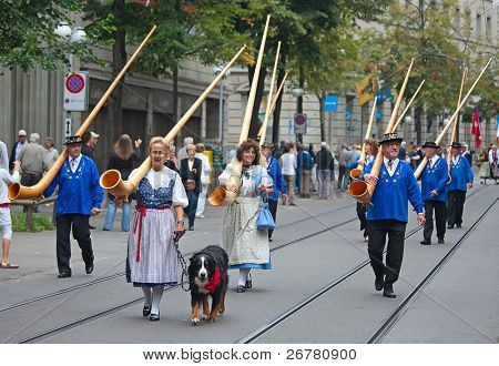 ZURICH - AUGUST 1: Swiss National Day parade on August 1, 2009 in Zurich, Switzerland. Musicians marching with traditional swiss alphorns