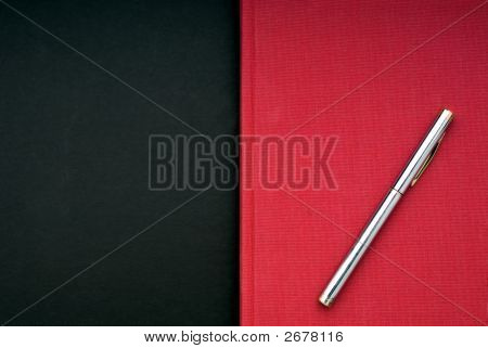 Bright Red Book On A Black Background