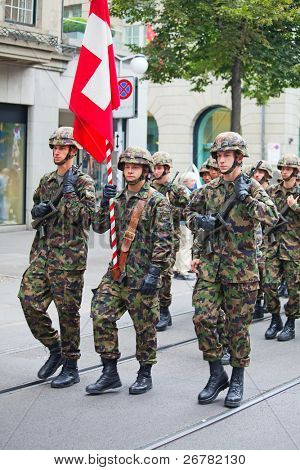 ZURICH - AUGUST 1: Infantery division of Swiss army marching in the Swiss National Day parade on August 1, 2009 in Zurich, Switzerland.