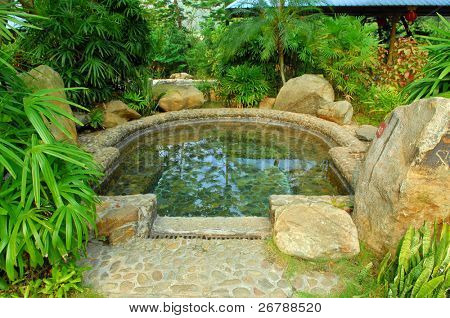 hot spring on a river with chinese gloriette