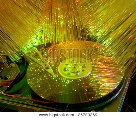 computer harddisk and heads on technology fiber optics background