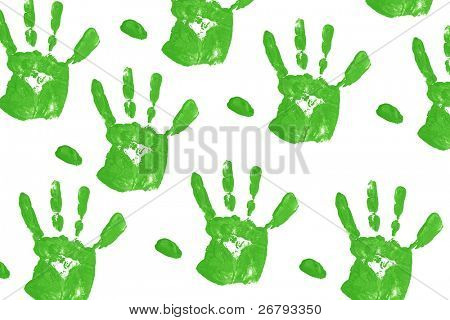 close up green child handprints on white