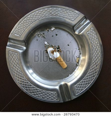 close up shot of cigarette butt in ashtray