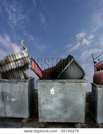 close up shot of dirty dumpsters with old furniture