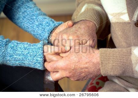 close up shot of hands holding each other
