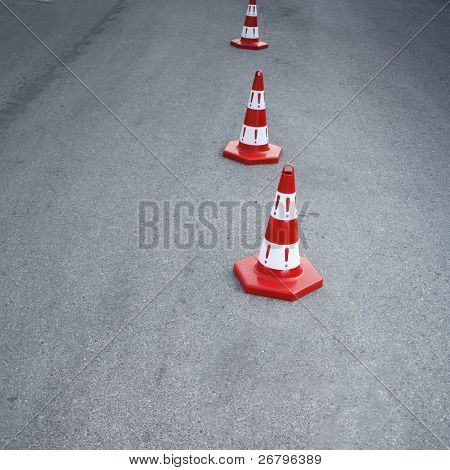 An image of cautions on asphalt road