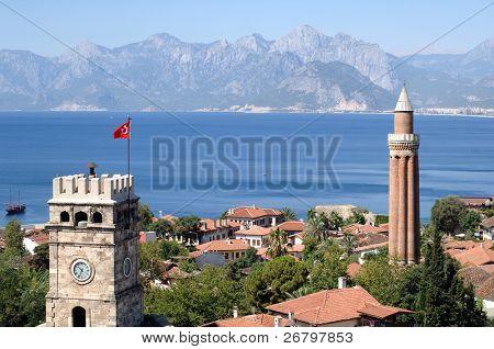 close up shot of a clock tower and minaret in Antalya