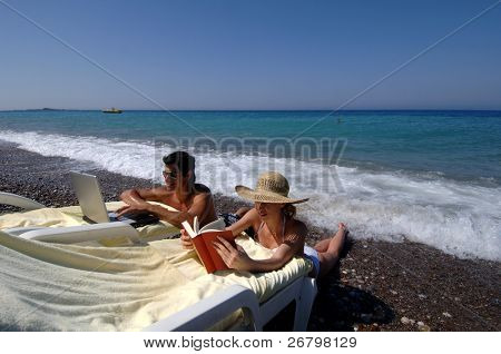 An image of a couple at the beach in a summer time