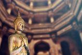 Spiritual Gold Buddha Statue In The Dark Temple, Meditating In Stone Castle poster