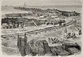 Antique illustration of railway station construction in Port Said, near unloading pier. Original, fr