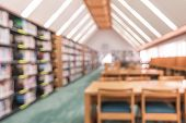 School Library Or Study Class Room, Education Blur Background With Blurry View Of Books On Bookshelv poster