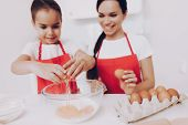 Girl Bake A Sweet Food. Girl Cook For Family. Mother Help Daughter With Biscuit Dessert For Girl. Mo poster