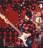 Bassist Concept. Man S Holds Bass Guitar, Play Music In Club Atmosphere Background. Musician, Artist poster