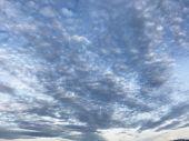 Defocused Natural Blue Cloudscape Landscape, Cirrocumulus Cloud Form Or Pattern In Bright Day Mornin poster