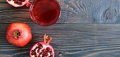 Ripe Pomegranate Fruit And A Glass Of Pomegranate Juice On Wooden Table. Healthy Eating Concept. Ban poster